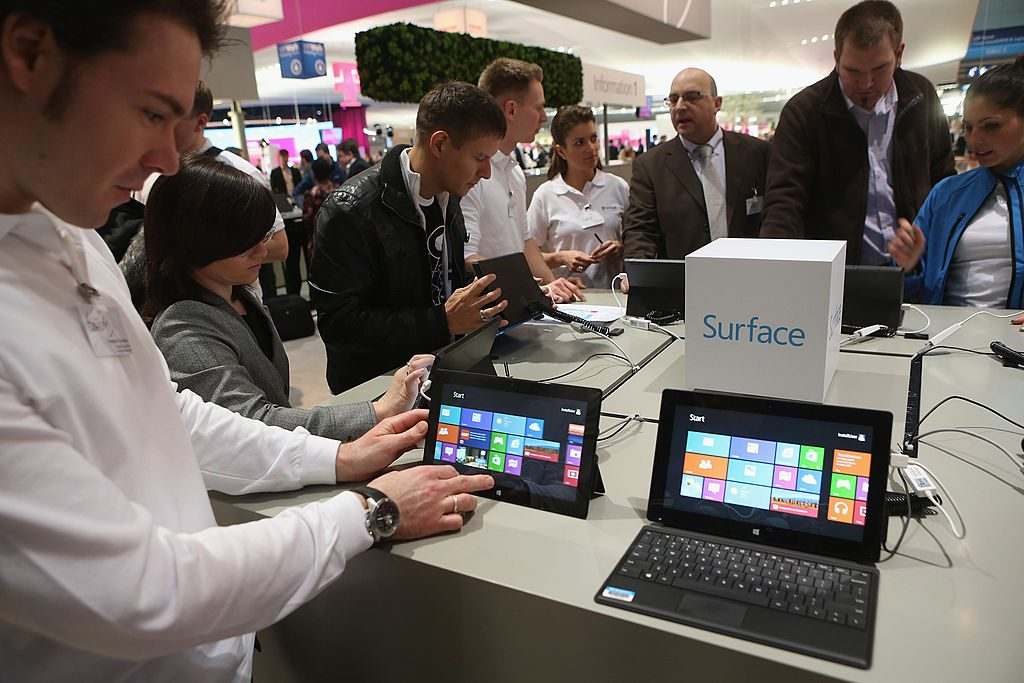 HANOVER, GERMANY - MARCH 05: Visitors try out Windows 8 Surface tablet computers at the Microsoft stand at the 2013 CeBIT technology trade fair on March 5, 2013 in Hanover, Germany. CeBIT will be open March 5-9. (Photo by Sean Gallup/Getty Images)