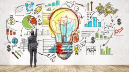 Businessman near blackboard with startup sketch